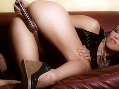 Brunette babe Celeste Star with hot ass and thong masturbates with big vibrator on the couch when she is alone in her house.