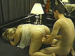 Kinky blonde milf pleases some guy with a blowjob. Then she takes his shaft into her meaty cunt and gets it fucked in cowgirl and missionary position and doggy style.