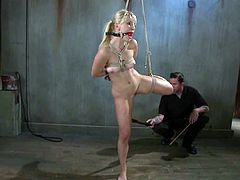 Masturbate watching this blonde, with knockers wearing white lingerie, while she gets touched with dirty toys when she is tied up and suffering.