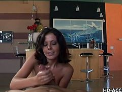 Hot brunette milf Penny Flame is ready to show amazing skills on his meaty cock. She strokes his cock like a real pro and wants to feel his big jizzload on her face.