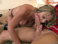 Lustful cougar gives passionate blowjob to younger man. Then she gets her wet pussy fucked and mouth filled with cum.