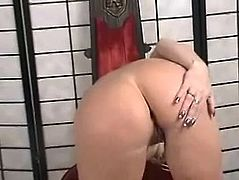 Prepare your cock for this hot cougar, with titanic knockers wearing black leather lingerie, while she uses her softly hands to masturbate herself.