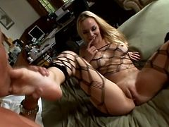Sweet blonde girl in bodystockings toys her vagina with glass dildo. After that she gets her soaking pussy and feet licked. In addition she gives a blowjob and gets her ass cum covered.