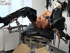 Take a look at this hot scene where the horny Miletta wears a latex mask as she plays with her wet pussy with her legs wide open.
