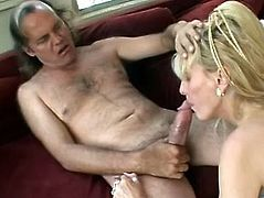 This blonde whore blow his big dick until it gets stiff and then that dude fucks her shaved mature cunt so hard and roughly.