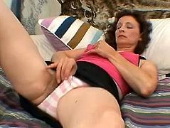 Fingering of that slimy and hairy vagina is what makes that mature slut horny, masturbation is her favorite thing to do when she is alone.