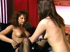 Two lusty hookers with big boobs in slutty stockings give blowjob to one lucky dude and lick each other's wet hairy coochies. Then whores get fucked doggystyle in turn.