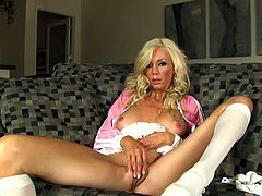 Alluring blonde with big boobs and tight vag enjoys a huge toy during rough solo