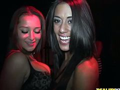 Sexy brunette Capri Cavalli and her GF are playing dirty games with some guy in public. They kneel in front of the man in the club and suck his boner till it explodes with cum.