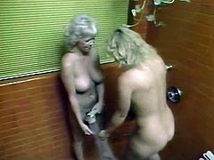 Blonde bombshell with big ass and big natural tits gets her meaty shaved cunt fucked missionary style. Then buxom MILF takes shower with her busty girlfriend and eats her tight hairy cunt.