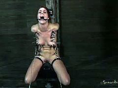After fucking Alisha Adams's mouth, her master ties her down to a pillar and forces her to sit on a sybian. This fucking machine makes her have multiple orgasms.