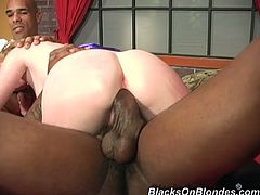 White chick with small tits stand on her knees sucking two big black cocks. Then she takes rough pussy pounding.