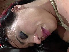 Slutty beauty with amazing forms receives a rough fuck in full BDSM porn scene