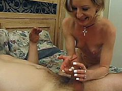 A lustful mature blonde is getting naughty with some dude indoors. She pleases the guy with a blowjob and then allows him to drill her pussy in missionary position.