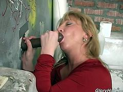 Horny white housewife heads to the ghetto where she sucks and fucks big, total stranger's black cocks through a bathroom gloryhole.