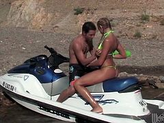 Get a hard dick watching this blonde babe, in a green bikini wearing pigtails, going hardcore outdoors over a jet sky. She loves swallowing his jizz!