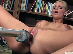 Sexy blonde chick undresses and oils her ass up in a library. After that she gets her ass and pussy toyed deep by the fucking machine.
