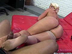 Click to watch this blonde cougar, with titanic love pillows wearing white stockings, while she masturbates a big black cock and moans like a slut.