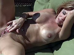 Felicity Rose is a lovely mature woman who gets turned on while she's sunbathing in her backyard. She pulls her panties aside and starts rubbing her pussy.