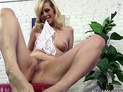 Witness this blonde cougar, with natural tits wearing white panties, while she enjoys her foot fetish and has interracial sex on the floor.