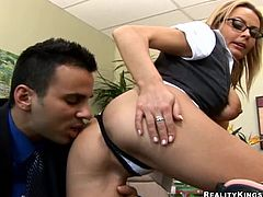 Nasty blonde Alexis May is playing dirty games with some guy in an office. They have passionate oral sex and then bang in missionary position on the desk.