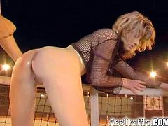 Have a blast watching this blonde MILF, with a shaved pink pearl wearing fishnets, while she goes hardcore with a horny dude in a tennis court.