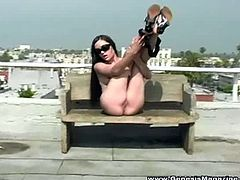 Genesis Magazine brings you a hell of a free porn video where you can see how the alluring brunette supoerstar Sasha Grey spreads her pussy on the balcony.