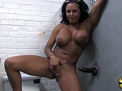 This amazing babe with gorgeous curly body is in toilet waiting for black glory hole cock. She is ramming that cock until he cum in her shaved pussy.