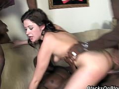 Get a hard dick watching this brunette, with born tits wearing a cute bra and black panties, while she has interracial sex and moans like a slut!
