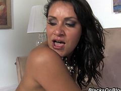 Have a blast watching this latina brunette, with gigantic boobs and a hairy pussy, while she goes really hardcore with a big dark guy.
