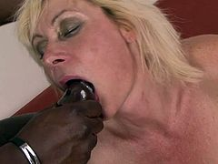 Mature blonde receives one large black snake to demolish her cramped pussy