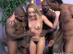 Tinslee is a hot white girl with a big bush who lets an entire group of black guys fuck her, double penetrate her, and cum all over her.