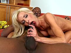 Check out this hot-ass interracial sex scene right here with this cock-hungry blonde whore and this horny black dude with a big dick!