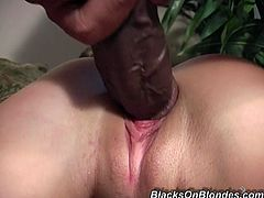 That slutty chick loves to eat sperm. She is getting drilled hard by this horny black dude and get big load of cum all over her face.
