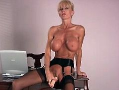 Kelly decides to relax at her workplace. So, she takes clothes off and starts to play with her pussy. She also drills her vagina with a dildo.