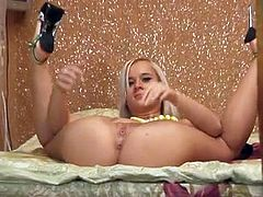 Anna F. is a cute blonde teen with a very flexible body. She can put her legs behind her back and she does so while naked. She also plays with her pussy with a dildo.