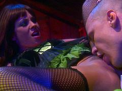 Brunette chick in fishnets blows a cock and gets her vagina licked well in the barn. Then Kirsten gives a titjob and gets fucked in a cowgirl pose. A guy cums on her tits.