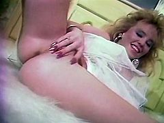 Charming light haired hussy in white lacy pantyhose exposes her round butt and strokes her trimmed snapper. Then you can see how two lesbians suck tits in pool.