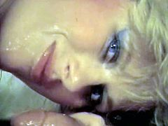 Voracious blonde beauty greedily sucks two big cocks and get her shaved cunt fucked doggystyle before taking mouthful. At the end you can see two horny babes in lingerie sucking one cock.