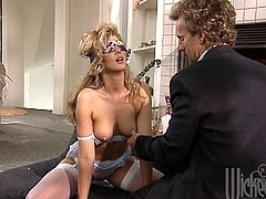 Retro chick in white lingerie and stockings gets blindfolded. She gets her tits and shaved pussy licked. After that she gives nice blowjob and get sfucked in a missionary pose.