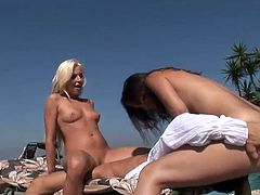 PlayBoy brings you a hell of a free porn video where you can see how a blonde and a brunette sluts get nasty by the poolside while sharing a hard cock and some intense lesbian moments.