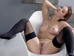 Anna Tatu is about to make you fall in love with her as you watch this horny hottie playing with her pussy while wearing stockings.