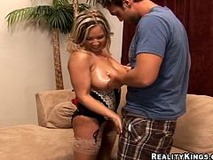 Curvy Rachel Love fondles her big natural tits and gets oiled up. She blows a dick standing on her knees and gets banged on a sofa. Of course a guy also fucks her between boobs.