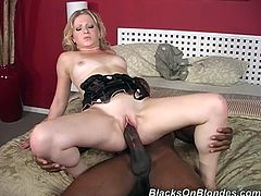 Lovely blonde girl gives a blowjob to Black guy. He has huge cock. He fucks Zoie so deep and hard that she screams loudly. This White babe also gets a mouthful.