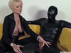 Nikki sixxx jerks her slave in leather