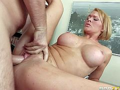 Krissy Lynn is a lovely woman with gorgeous huge boobs. She shows her massive melons to handsome student Manuel Ferrara to turn him on. He loves her hooters and her pink wet hole. He drills her twat like crazy!
