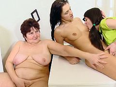 Horny dolls are playing nasty with their mature teacher in lesbian action