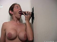 Stunning babe with astonishing delicious big boobs sucking deeply big black gloryhole cock until he spills big load of sperm in her mouth.