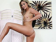 Natalia Forrest parts her legs to fuck herself with toy