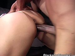 After sucking his big, black cock, this white girl gets her pierced pussy pounded in several different positions on the bed.